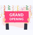 hand holding grand opening banner colorful vector image