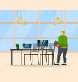 man standing near table with computer at office vector image vector image