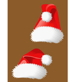 Two red christmas hats of Santa Claus vector image vector image