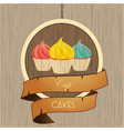 cupcakes trio on wooden sign with rope details vector image vector image