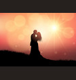 silhouette of a wedding couple on sunset vector image