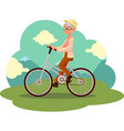 Stylish elder woman old lady riding a bicycle vector image