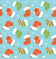seamless pattern with christmas stocking vector image vector image