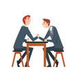Two businessmen arm wrestling business people