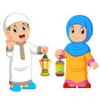 moslem couple holding lantern vector image vector image