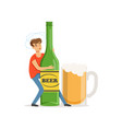 young man holding oversized bottle of beer vector image vector image