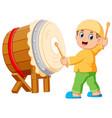 a boy playing bedug cartoon vector image vector image