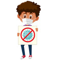 boy wearing mask and holding stop coronavirus sign vector image vector image