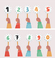 hands holding score cards numbers set vector image vector image