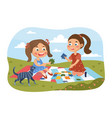 two young girls playing with a jigsaw puzzle vector image vector image