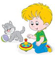 Boy plays with a whirligig and kitten vector image vector image