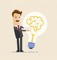 businessman hugs a big lightbulb brain big good vector image