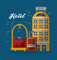 hotel building hotel luggage trolley suitcases vector image