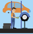 mechanic performs wheel balancing vector image vector image