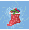 Christmas sock on blue background vector image vector image