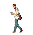 bearded male pedestrian looks at a mobile phone vector image