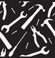 seamless texture with silhouettes of working tools vector image