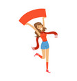 smiling football fan girl character in red holding vector image