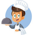 cute little chef boy holding cloche platter vector image
