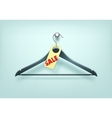 Clothes Black Plastic Hanger with Sale Tag Label vector image vector image