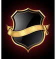 black and gold shield and ribbon vector image