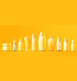 yellow cosmetics packs on bright background vector image