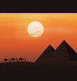 caravan with camels in desert with pyramids vector image vector image