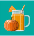 Jar with pumpkin smoothie with striped straw
