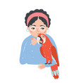 portrait of woman in glasses holding her macaw vector image