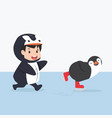 Little kid characters in penguin costume with