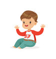 cute smiling little boy dressed in jeans and vector image vector image