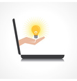 hand holding light bulb comes from laptop screen vector image vector image