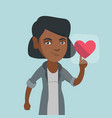 young african woman pressing heart shaped button vector image vector image