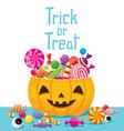 Halloween Pumpkin Bucket with Candy vector image