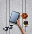 hands holding tablet computer with cup of coffee vector image