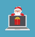 laptop with gift santa claus giving gift on vector image vector image