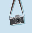hanging vintage camera in a flat style vector image