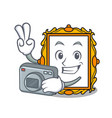 photographer picture frame mascot cartoon vector image