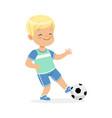 boy playing soccer kid kicking a ball colorful vector image
