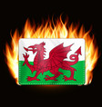 concept wales flag on fire background country vector image