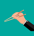 kitchen asian chopsticks in hand vector image