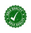 gold quality grunge stamp with tick vector image vector image