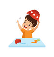 boy dabbling with food at table cute naughty kid vector image vector image