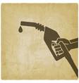 hand with gasoline fuel nozzle on vintage vector image