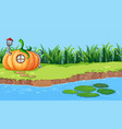 pumpkin house next to the river vector image vector image