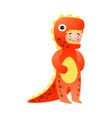 cute young boy in red yellow color dinosaur vector image vector image