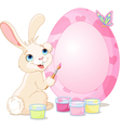 Easter bunny painting easter egg vector | Price: 1 Credit (USD $1)