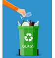 man hand throws garbage into a glass container vector image