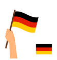 human hand holding flag of germany vector image