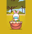 cute rabbit near basket with eggs wearing mask to vector image vector image